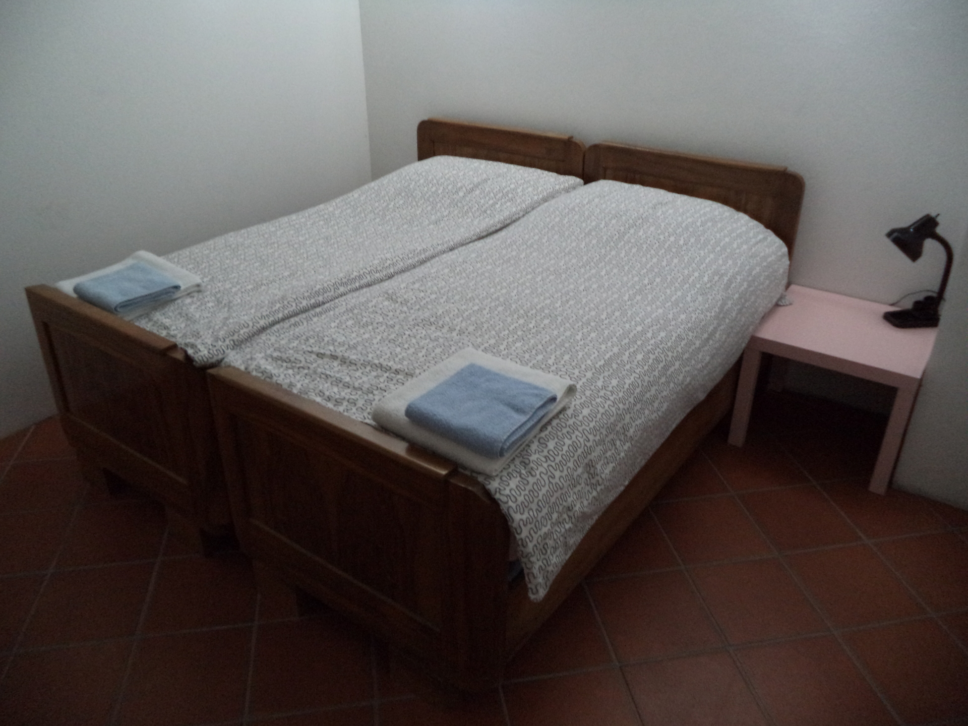 The double beds in the main bedroom